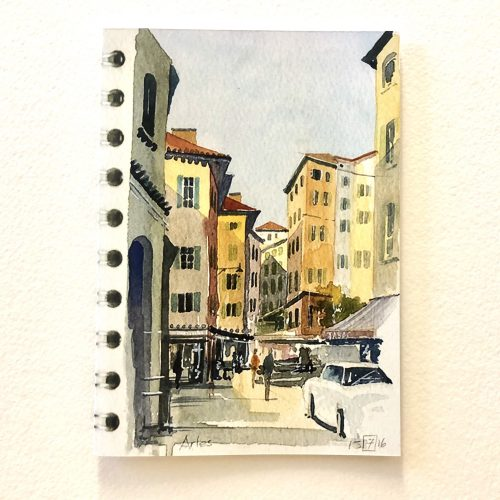 a greeting card design completed as a coloured sketch of Arles in France